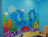 Coral reef mural with turtles and dolphins