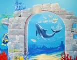 Coral reef mural with arch and dolphin